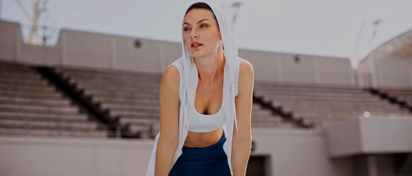 Woman in active wear posing during photo production