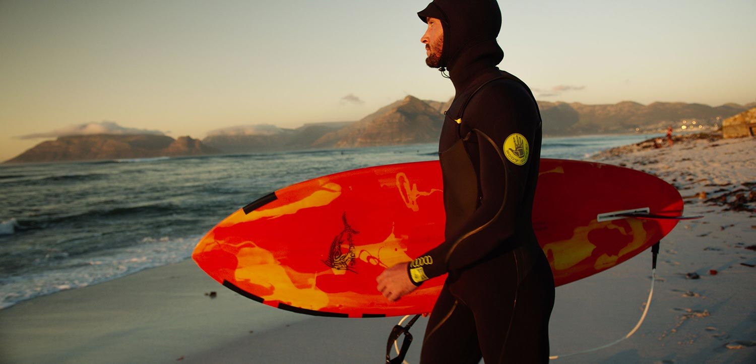 Surfer on the beach during video production in Cape Town.